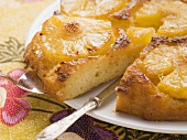 Pineapple upside-down cake, a piece cut