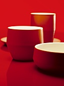 Various red bowls and beakers