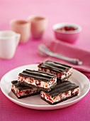 Chocolate-coated cherry and coconut slices