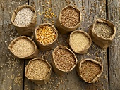 Various types of cereal grains in paper bags
