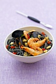 Black spaghetti with shellfish and prawns
