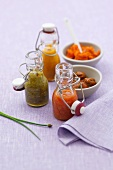 Three chilli sauces in bottles, lobster paste & marinated shellfish