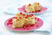 Baked goat's cheese with almonds and pomegranate seeds