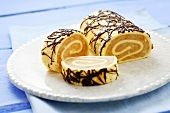 Sponge roulade with apple filling and chocolate decoration