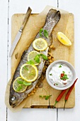 Trout stuffed with lentils, with chilli yoghurt