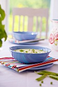Cheese soup in two blue bowls