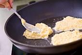 Frying potato rösti in a frying pan
