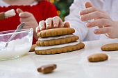 Children making Christmas tree from ginger biscuits