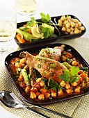 Chicken legs and sausages on Mediterranean-style beans