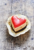 Heart-shaped petit four in paper case