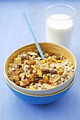 Muesli with dried fruit and nuts and a glass of milk