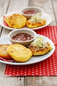 Small cheese pancakes with sprouts and tomato dip