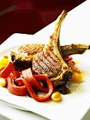 Grilled lamb chops on peppers and raisins