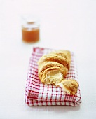 A croissant and apricot jam