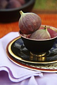 Two figs in a bowl
