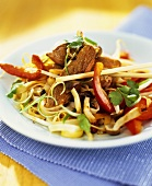 Stir-fried rice noodles, beef and vegetables