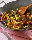 Beef and vegetables in wok