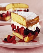 Sponge cake filled with berries and whipped cream