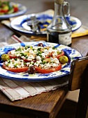 Tomato salad with goats cheese and olives