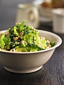 A bowl of savoy cabbage with nuts