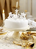 Christmas cake decorated with stars on a cake stand