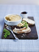 Hummus and tapenade on crostini