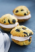 Whoopie Pies with blueberries on a blue tablecloth