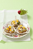 Canapes with soused herring, oranges and lemons