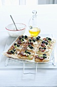 Pizza slices with black olives, Chorizo or ham