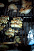 eggplant and ground beef rolls on the grill