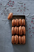 Chocolate macaroons in an old tin
