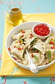 Swabian raviolis with spinach-bean filling and chili olive oil