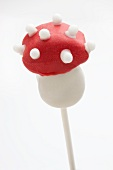A toadstool-shaped cake pop