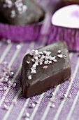 A diamond-shaped marzipan and nougat praline with sugar strands