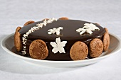 Chocolate cake with macaroons and sugar flowers