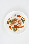 Spring chicken breast filled with pears and vegetables served with carrot juice