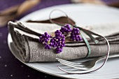 A place setting with a napkin and beautyberries
