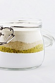 Icing sugar, ground pistachios, ground almonds and flour in a jar