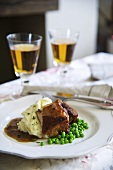 Ale-braised pork with mashed potatoes and peas