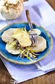 Gratinated sliced celeriac with buckwheat and scamorza