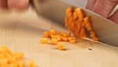 A carrot being chopped