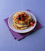 Buttermilk pancakes with maple syrup and berries