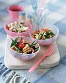 Tuna and bean salad, tabouleh and rice salad with chicken