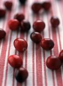 Cranberries on striped cloth