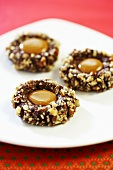 Chocolate and nut biscuits with caramel centre
