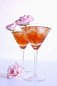 Twp Glasses of Rose Hip Iced Tea with Pink Flowers