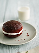 Red Velvet Whoopie Pie on a Plate; Glass of Milk