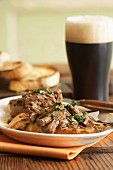 Braised beef on bread with a glass of stout
