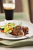 Mediterranean pork chops with courgettes and carrots and a glass of beer