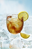 A glass of ice tea with lemons on ice